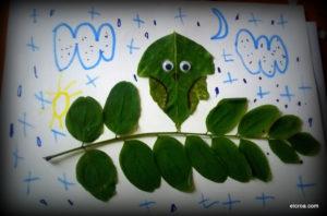 Cuadro con hojas un búho posado en una rama